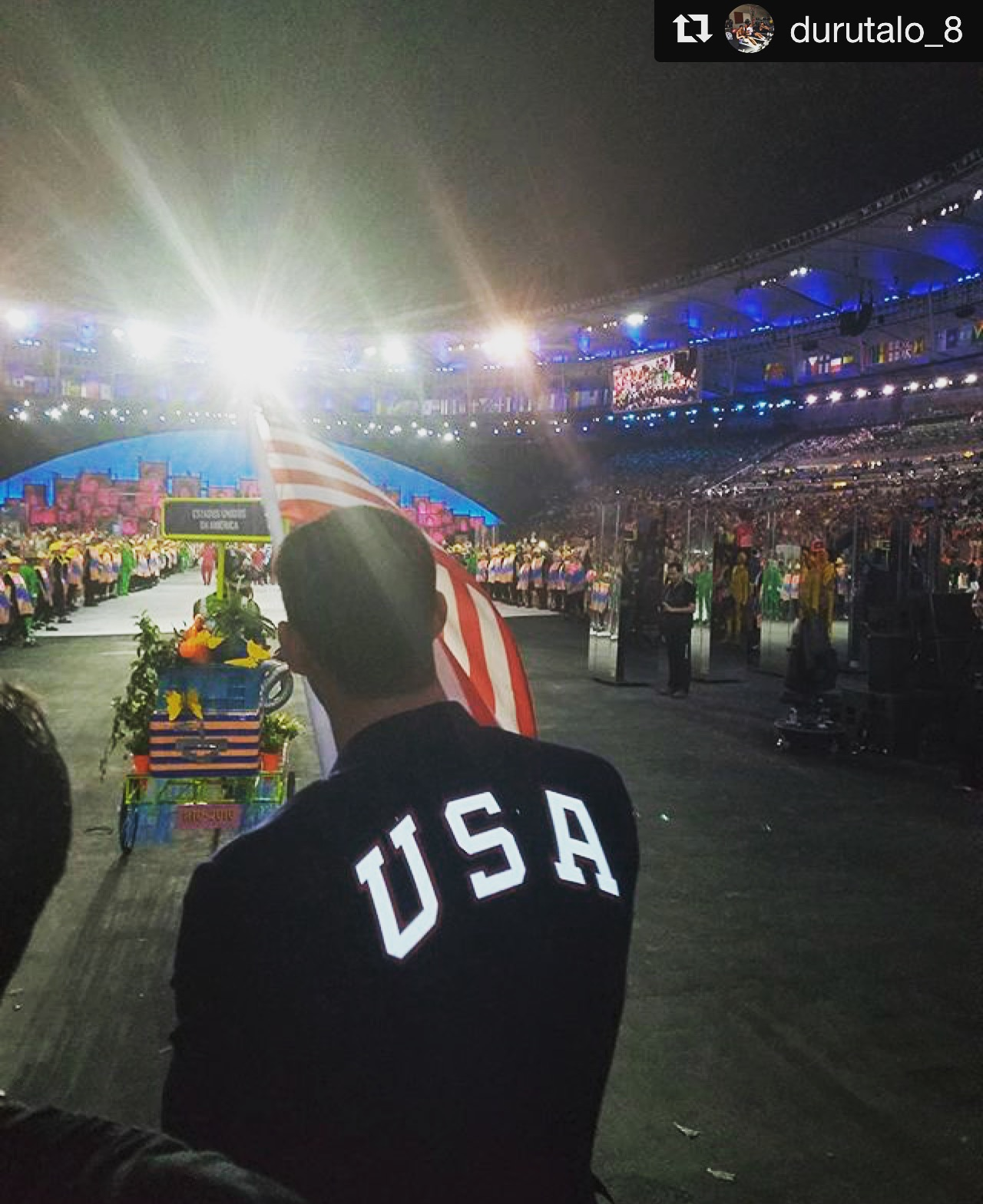 Men's Eagle Andrew Durutalo walking beside Michael Phelps, USA flag bearer, during the Olympic opening ceremonies
