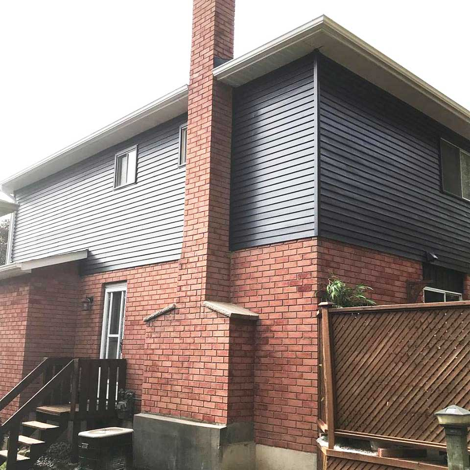 Sprayed aluminum siding (side view) - Hollis Crescent