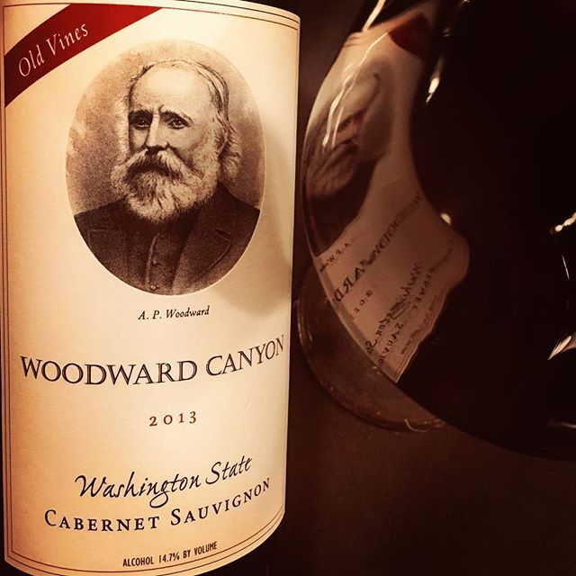 @woodwardcanyon #cabernetsauvignon #2013redwine #oldvines I increasingly appreciate this cuvée every time taste it. It's a consistent performer of reflective terroir, which is an amazing concept for a wine from such a young wine region. However Woodward Canyon, one of the oldest estates in Walla Walla are one of the few properties in the region that are already able to really 'reflect a sense of place' within their wines. This dense cuvée is produced from some of the oldest Cabernet vines in the whole valley. At its core it's a tertiary wine. On the nose there's complex autumnal notes of wet bark, soil and wet moss intermingled with roasted and grilled meats, bacon, blueberries, minerals, light vanilla and menthol. It's a dark, dense wine, powerful in the mouth with a slight sweaty saddle note. Superb depth, it's rich and sturdy, full-bodied with supportive acidity and tannic, it's quite four square...mineral and feral:like walking through a dark forest...but it's a wine that retains a real spark within its dark core. Decedent but with identity the wine ends long with a soaring bitter chocolate finish. It's always been a very age-worthy cuvée -up to 12. Classic. #wine #washingtonwine #wallawallawine #redwine #wallawallawineries #wallawalla #cabernetsauvignon #winetasting #winenight #winestagram #winelover #washingtonwineries #winery #woodwardcanyonwinery #wineblogger #blogger #vino #drinkingwine #wineeveryday #cheers 🍷