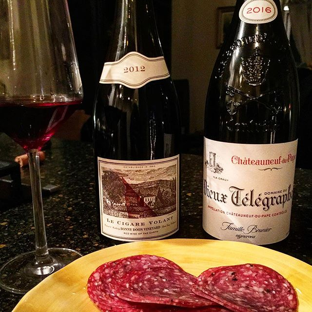 Saturday night 🍷🍷 • #chateauneufdupape #domaineduvieuxtelegraphe #2016redwine • #lecigarevolant #bonnydoonvineyard #2012redwine • • A great comparison between a young classic Chateauneuf du Pape and a classic superb Chateauneuf 'look- a like': Randell Grahm's the 'Cigar Volant' -produced from a good vintage. It was a example to see how these spicy varietals age and especially in the context of where they are grown. No doubt both were top notch wines sporting spicy and black fruity bouquets, but the CV obviously tasted softer, richer with more depth than the much more pure, direct, concentrated and sturdier constructed Vieux Telegraphe. At the moment the CV comes out tops, with a sweeter, more textured core of hot climate juiciness, however with time the VT will expand, gain weight, complexity and will prove to be the winner with bottle age between the two. Most importantly the VT has a sturdier framework, higher acidity and powerful tightly packed grainy tannins. The CV is actually drinking better now between the two, but the VT has a real time to go (maybe up to 20) so forget about it. Both are spicy and toothsome-delicious. Bought at @thethiefshop 😁  #wine #video #winepairing #winetasting #winelover #winestagram #winenight #wineglass #winephotography #winewinewine #wineblogger #wineenthusiast #cheers 🍷
