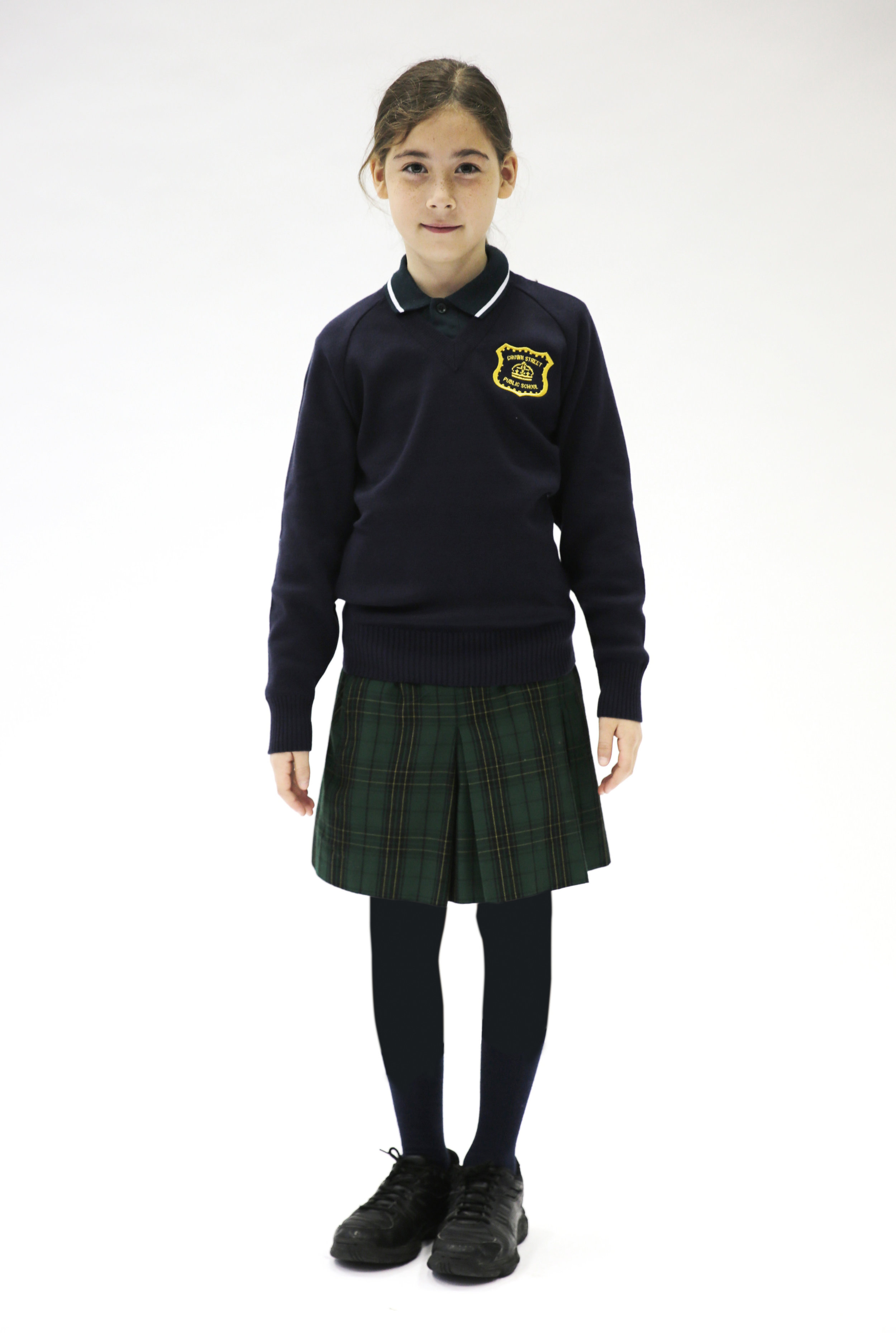 Long sleeve polo, jumper, tartan skirt, navy tights