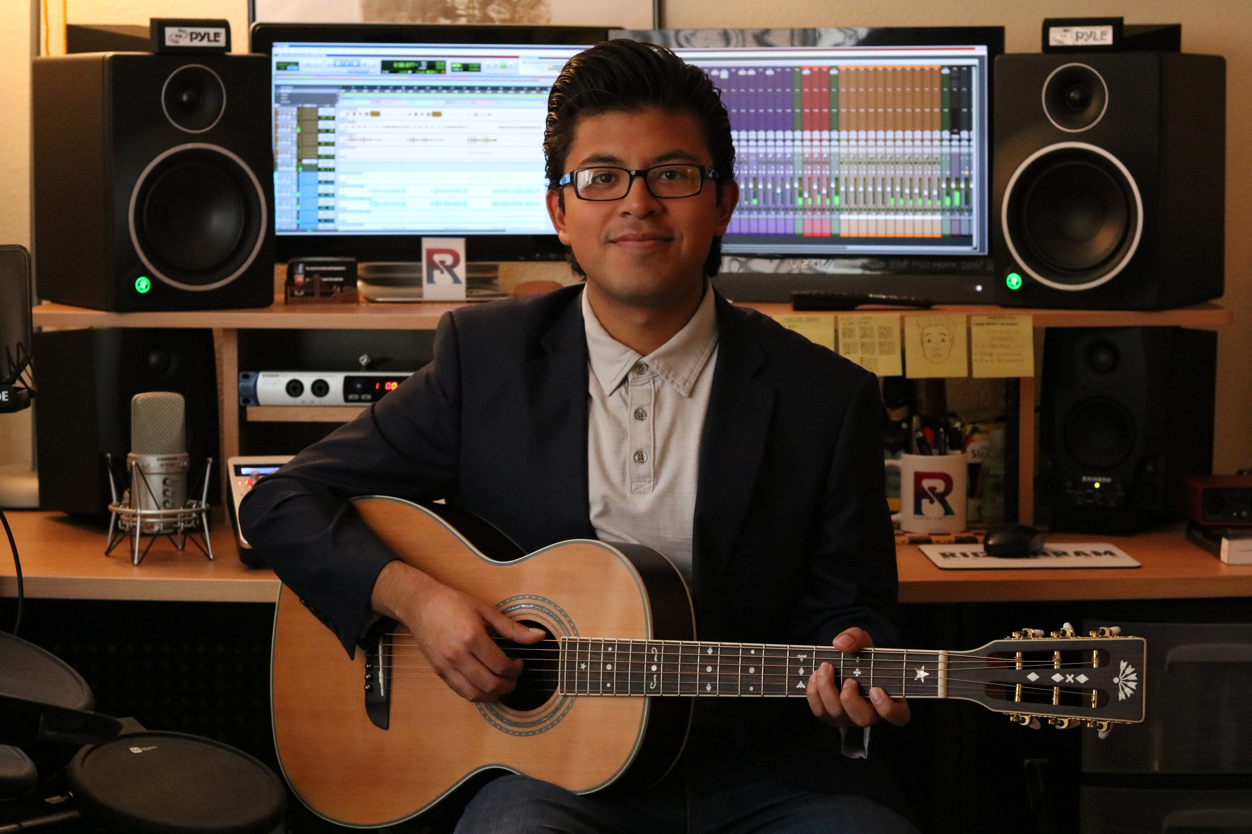 Ricardo Santiago is a musician, songwriter, producer, and audio engineer from Southern California. Ricardo is credited as a composer and performer on multiple professional released albums. In 2015, RICSANRAM records was founded by Ricardo. Ever since, RICSANRAM records has been working with artists and directors in both music and film. Currently, Ricardo and RICSANRAM records are working on a new original album composed by Ricardo, and on a themed original album by one of his side projects, Summer Days.