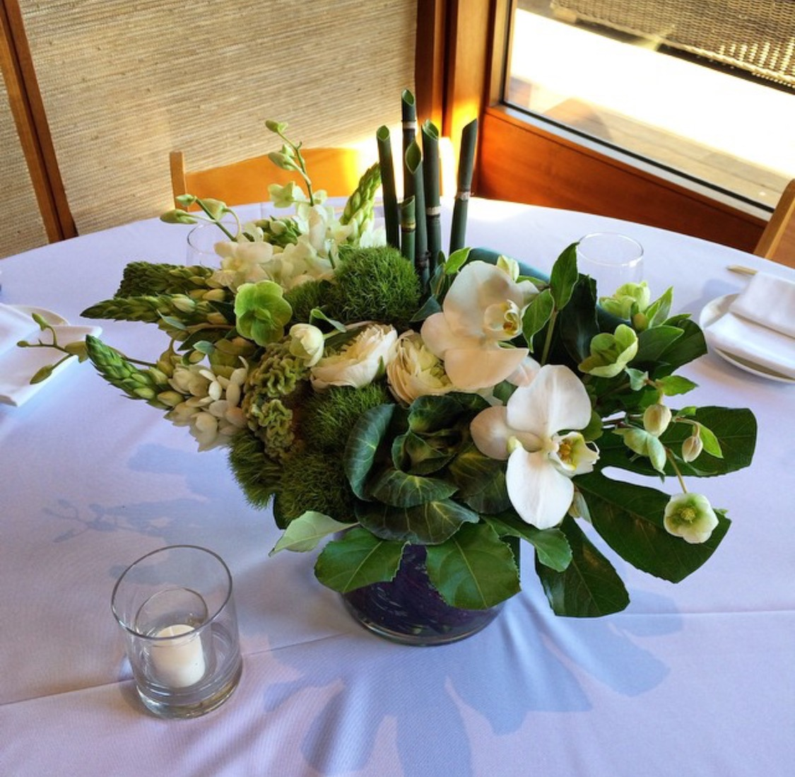 27. Modern White and Green Centerpiece