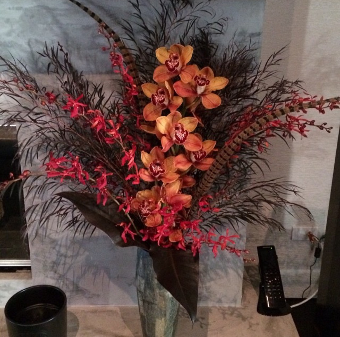 32. Dramatic Dark Tropical Arrangement