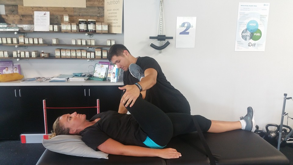 Above is stretch therapist tyler working with a athlete.