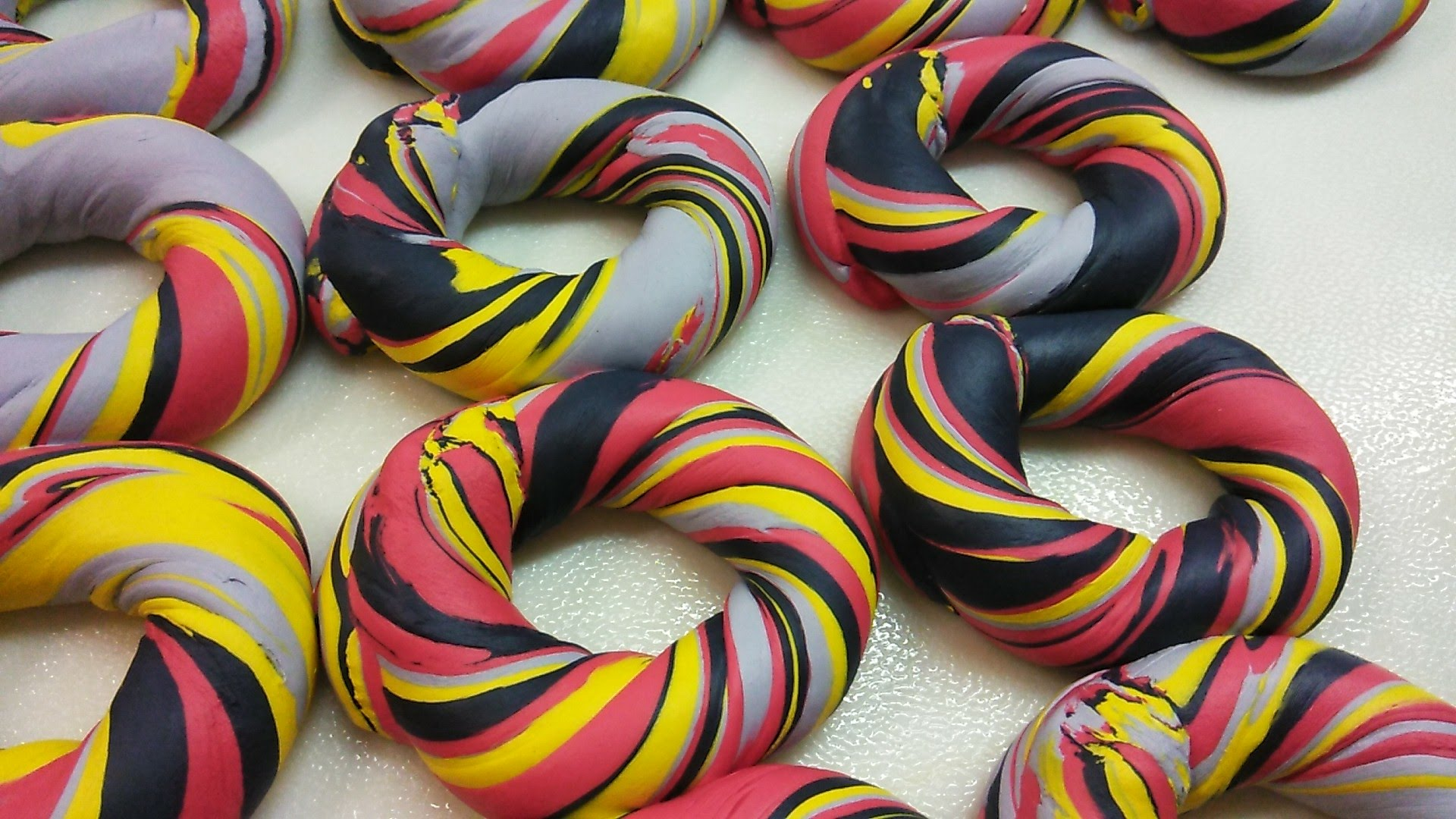 red , yellow ,silver and black custom bagel art