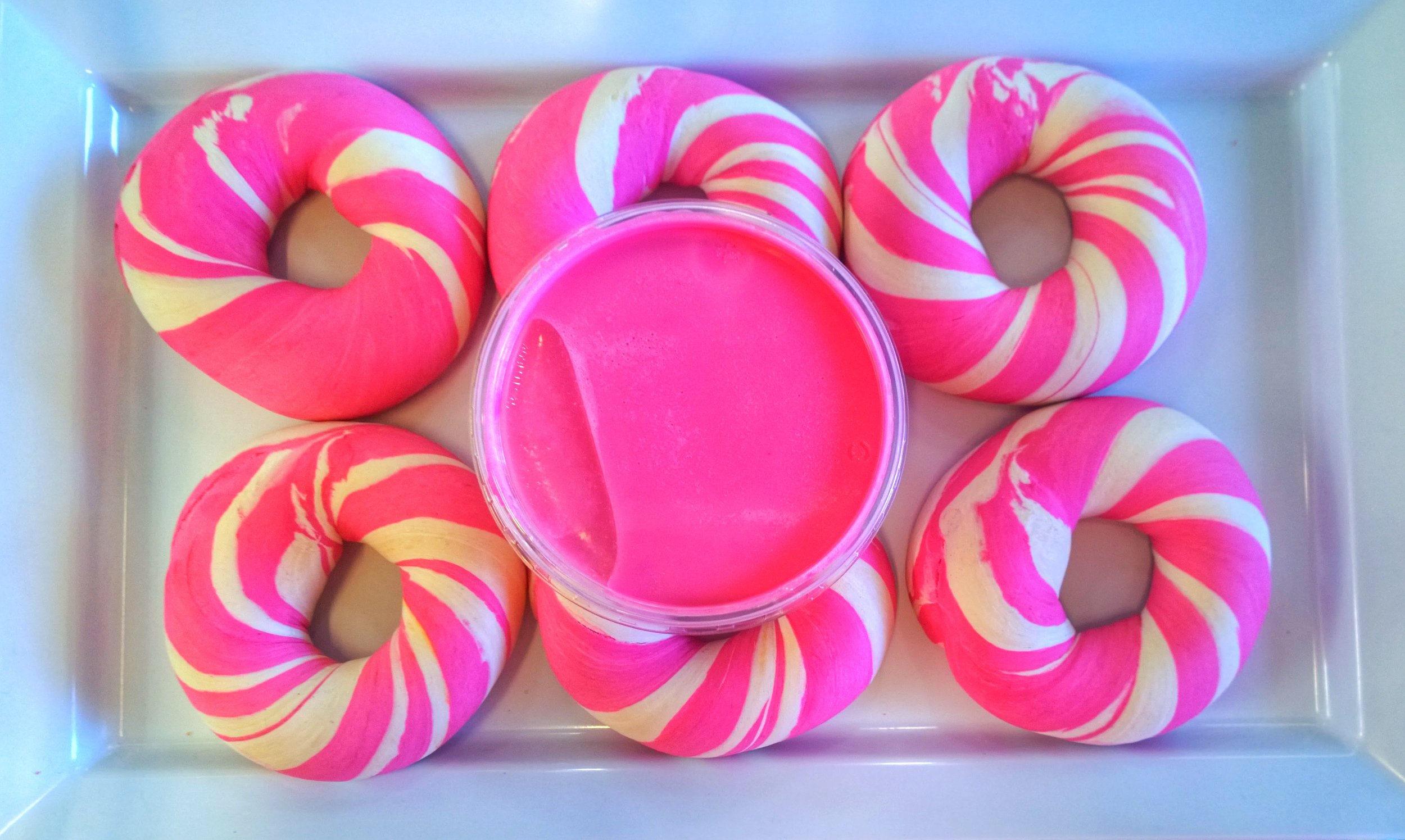 pink and white bagel with pink cream cheese