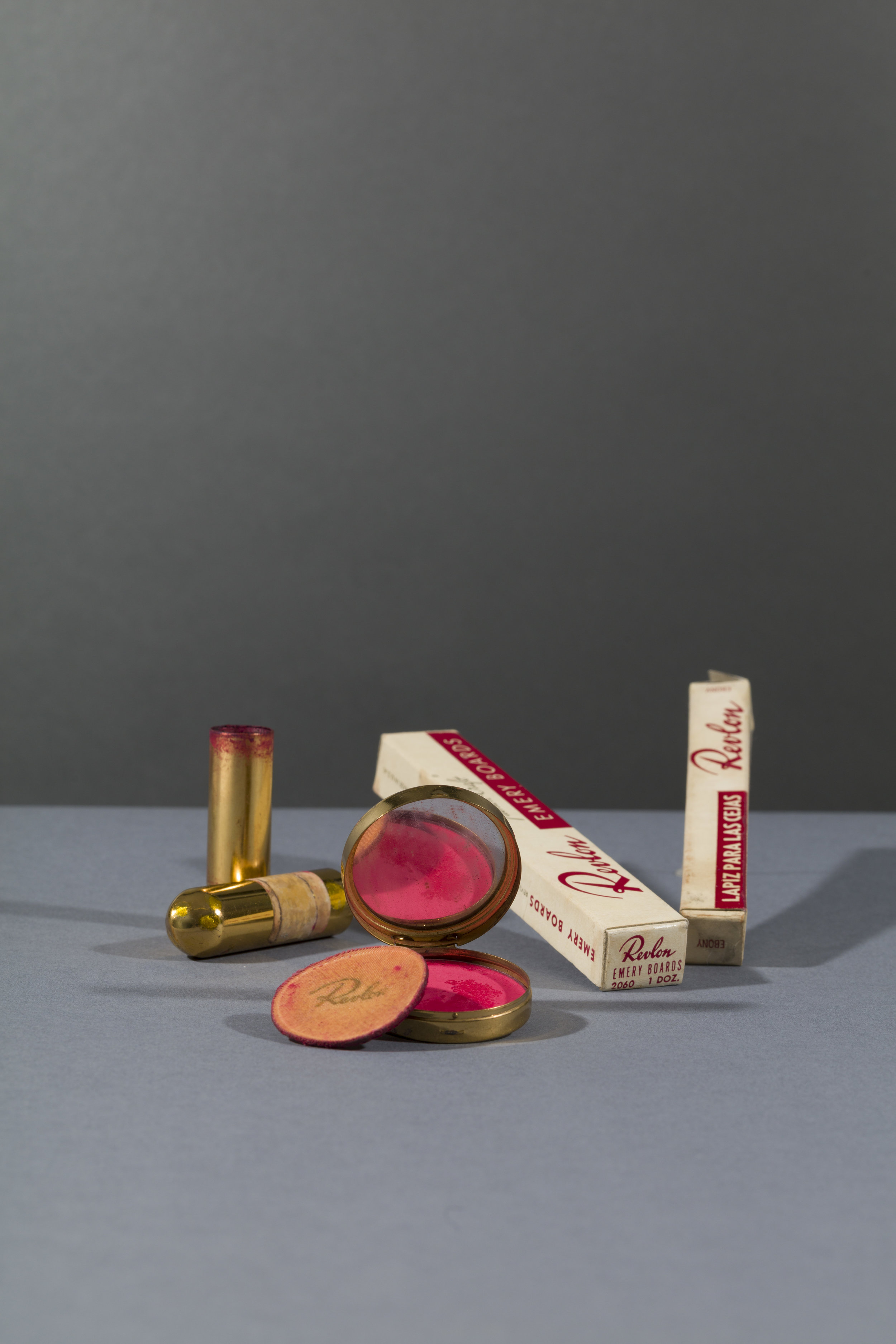 Revlon compact and powderpuff with blusher in 'Clear Red' and Revlon lipstick in 'Everything's Rosy'; emery boards and eyebrow pencil in 'Ebony'. Before 1954. Photograph Javier Hinojosa. © Diego Riviera and Frida Kahlo Archives, Banco de México, Fiduciary of the Trust of the Diego Riviera and Frida Kahlo Museums