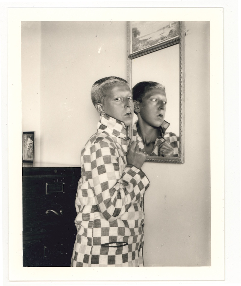 Claude Cahun,  Self-portrait (reflected image in mirror, checked jacket) , 1928. Courtesy of Jersey Heritage Collections