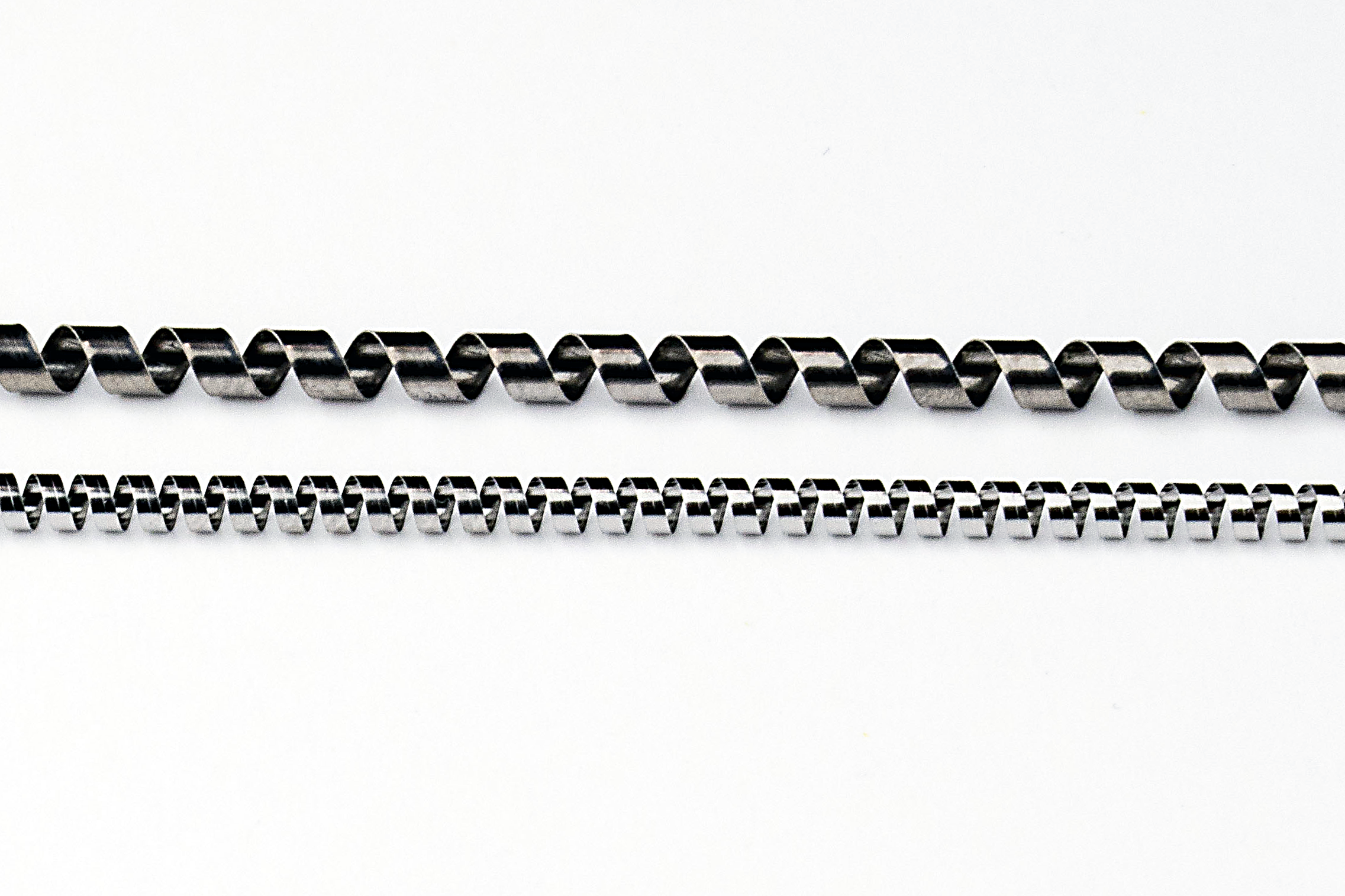 LOW LOAD ELGILOY AND TITANIUM SPRINGS FOR EMI SHIELDING