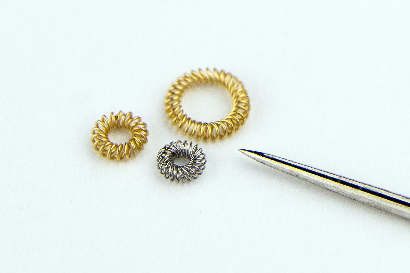 MICRO PLATED SPRING BESIDE SEWING NEEDLE
