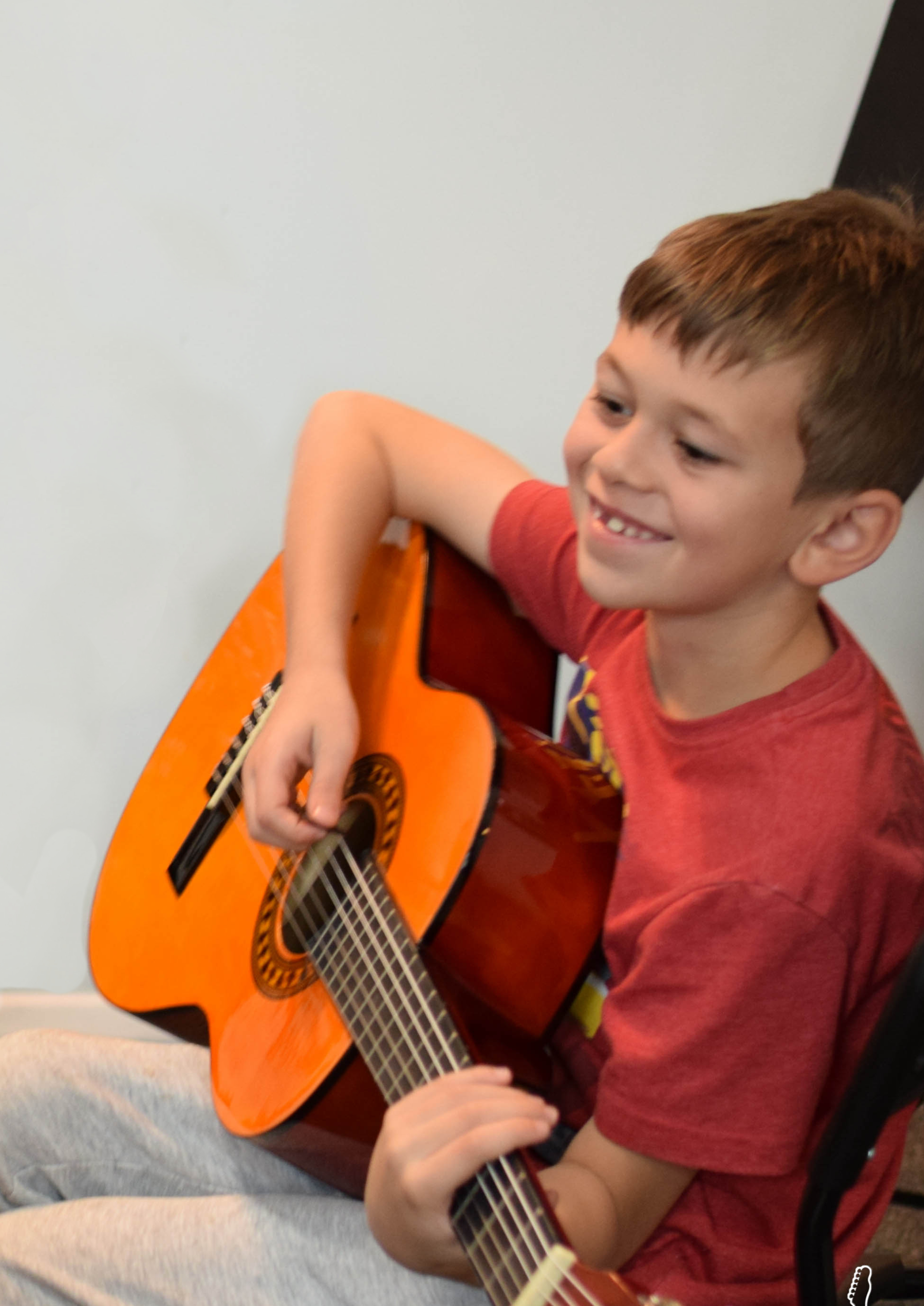 Coby, one of our students in a guitar lesson