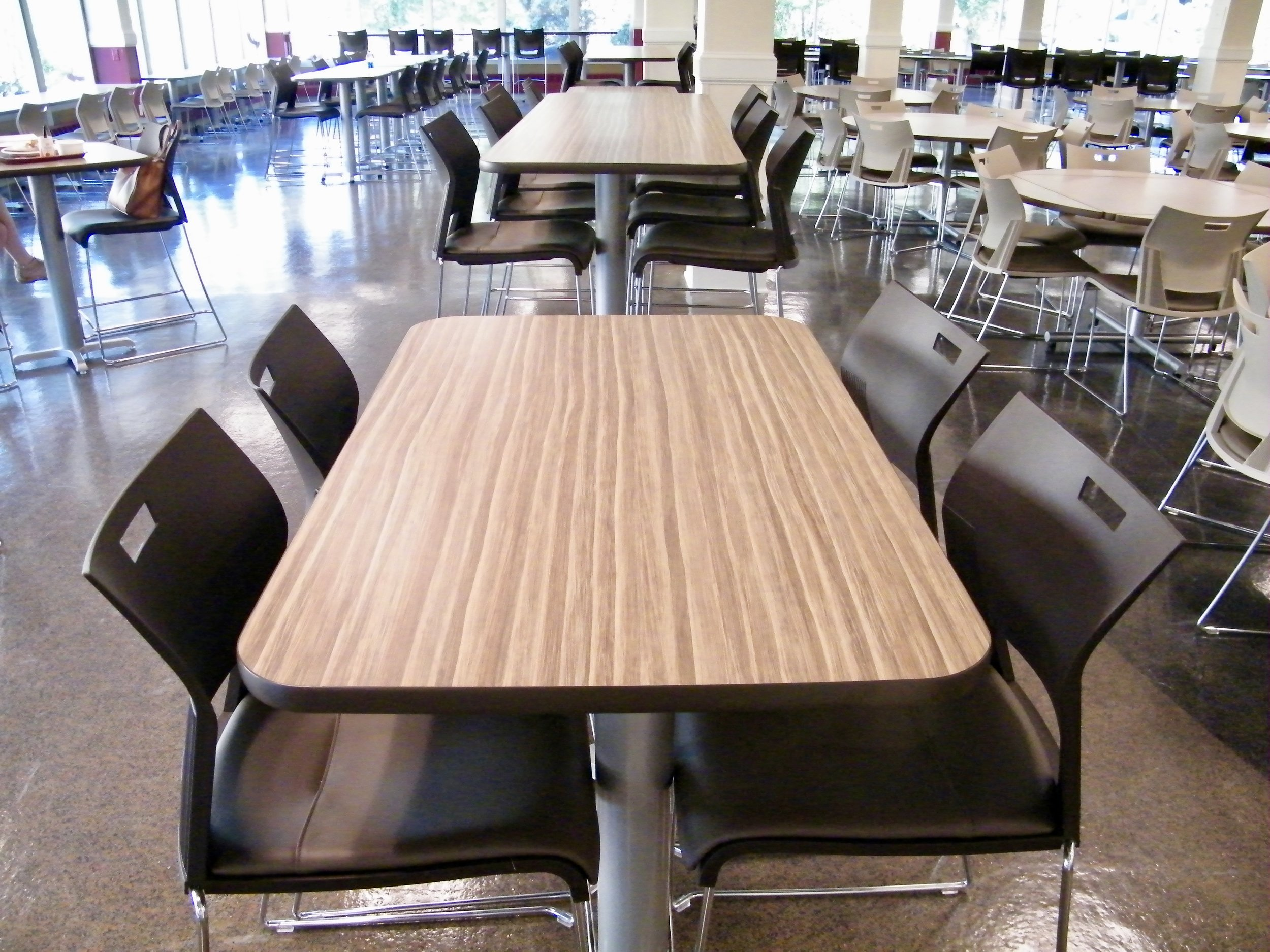 counter height duet chairs with laminate top pvce edge tables in university dining setting