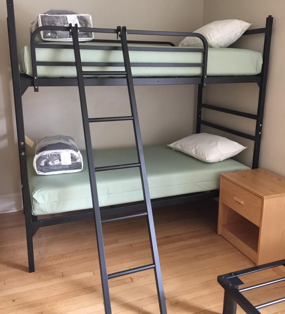 Metal bunk beds with tilted ladder