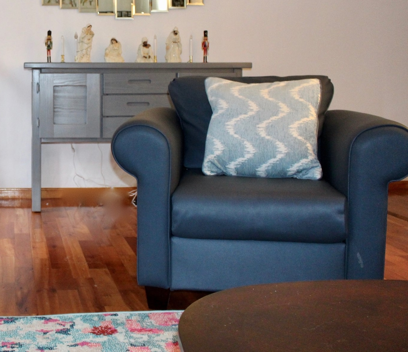 Hannah Rocker and classic sideboard in lving room on location