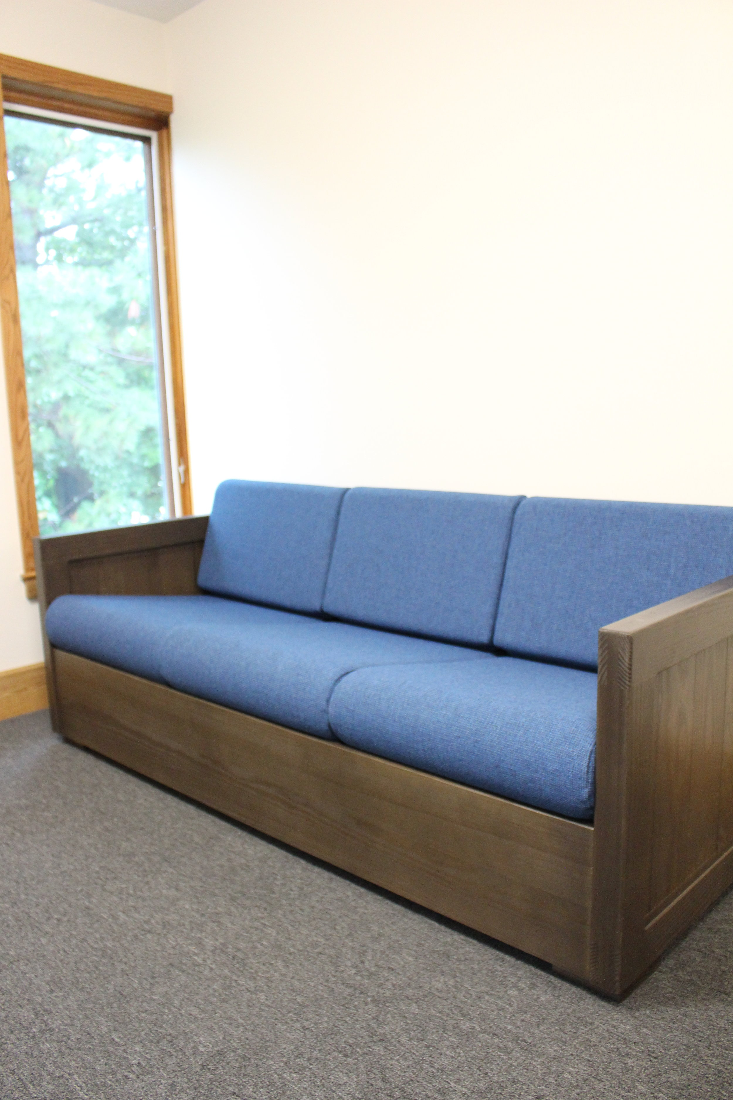 CLassic sofa in espresso finish with sherpa navy fabric cushions