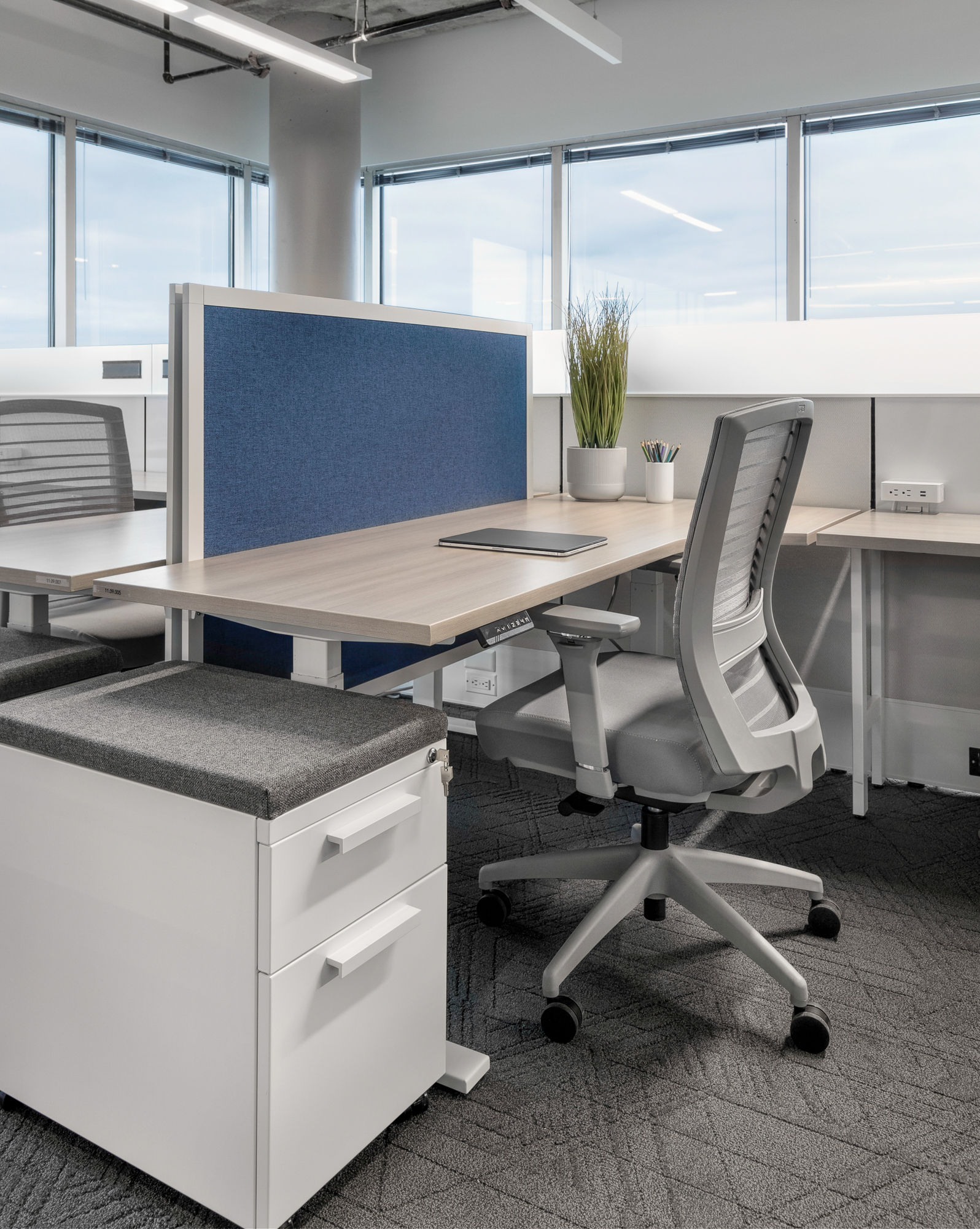 Hieght adjustable with privacy screens and L series storage, matrix panels and natick seating