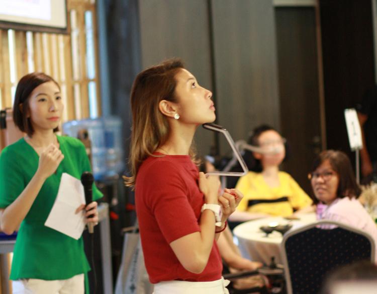 Speech Therapist Melissa demonstrating swallowing strengthening exercises