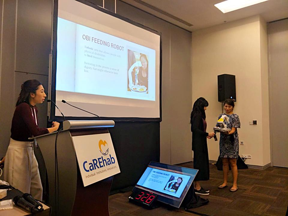 Demonstrating the OBI Feeding robot to the delegates at CaREHAB Conference 2018