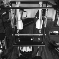 A view of one of our five, Pilates Trapeze Tables, also known as Cadillacs. These are the most versatile pieces of equipment in the Pilates Equipment repertoire. Anything from the most precise rehabilitation exercises to hanging gymnastics and trapeze work can be done on a Cadillac.