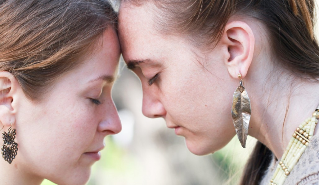 women praying-self-love-forgiveness-heartbreak-meditation
