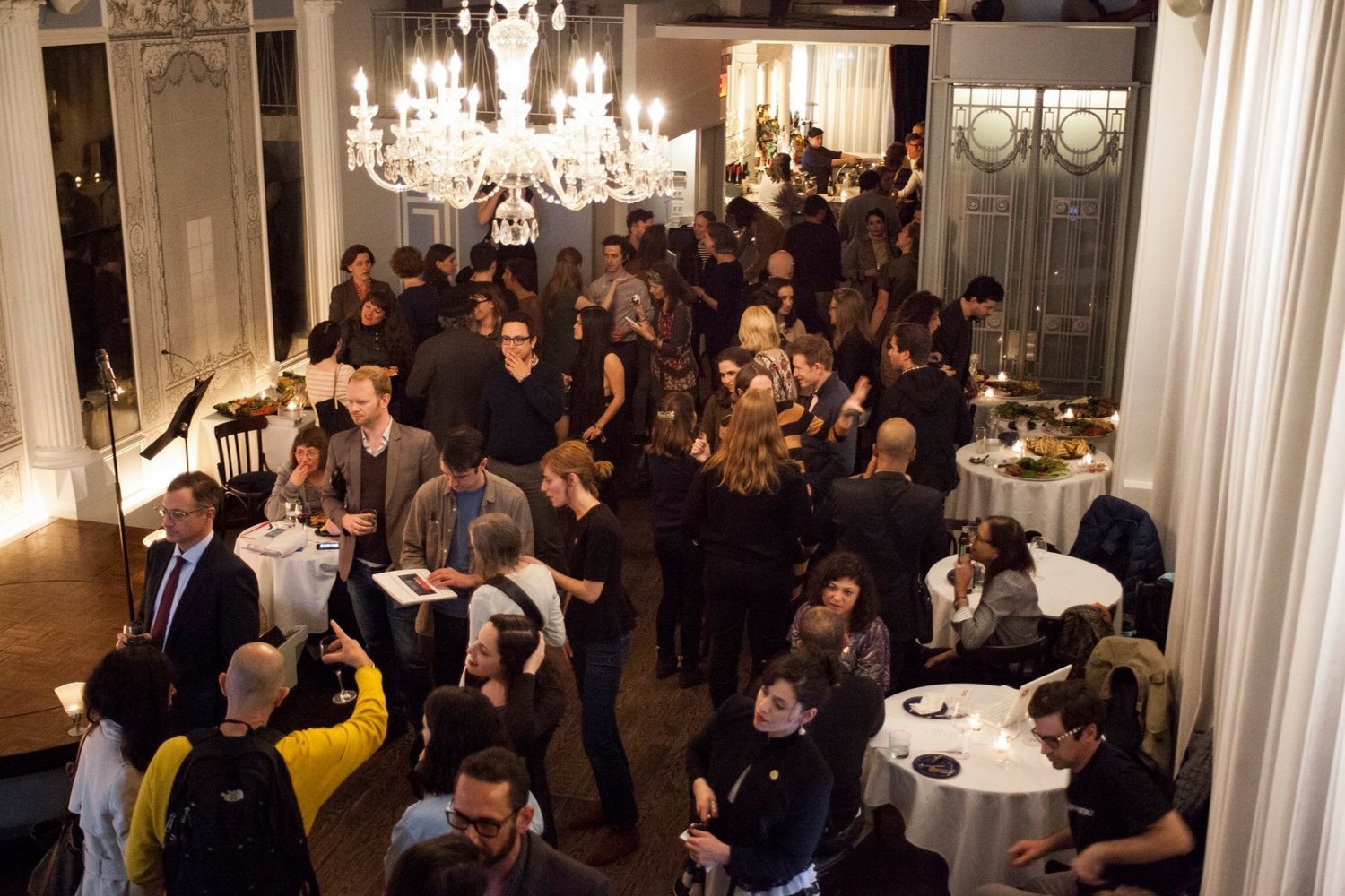 Celebrating the launch of Telephone at the Bowery Poetry Club in Manhattan. Concurrent parties and get-togethers took place all over the world and Telephone artists from all 42 countries were speaking to each other via video chat.