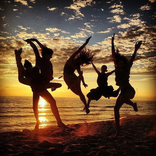Our dancers leaping on the beach. Lake Michigan in the summer is Heaven.