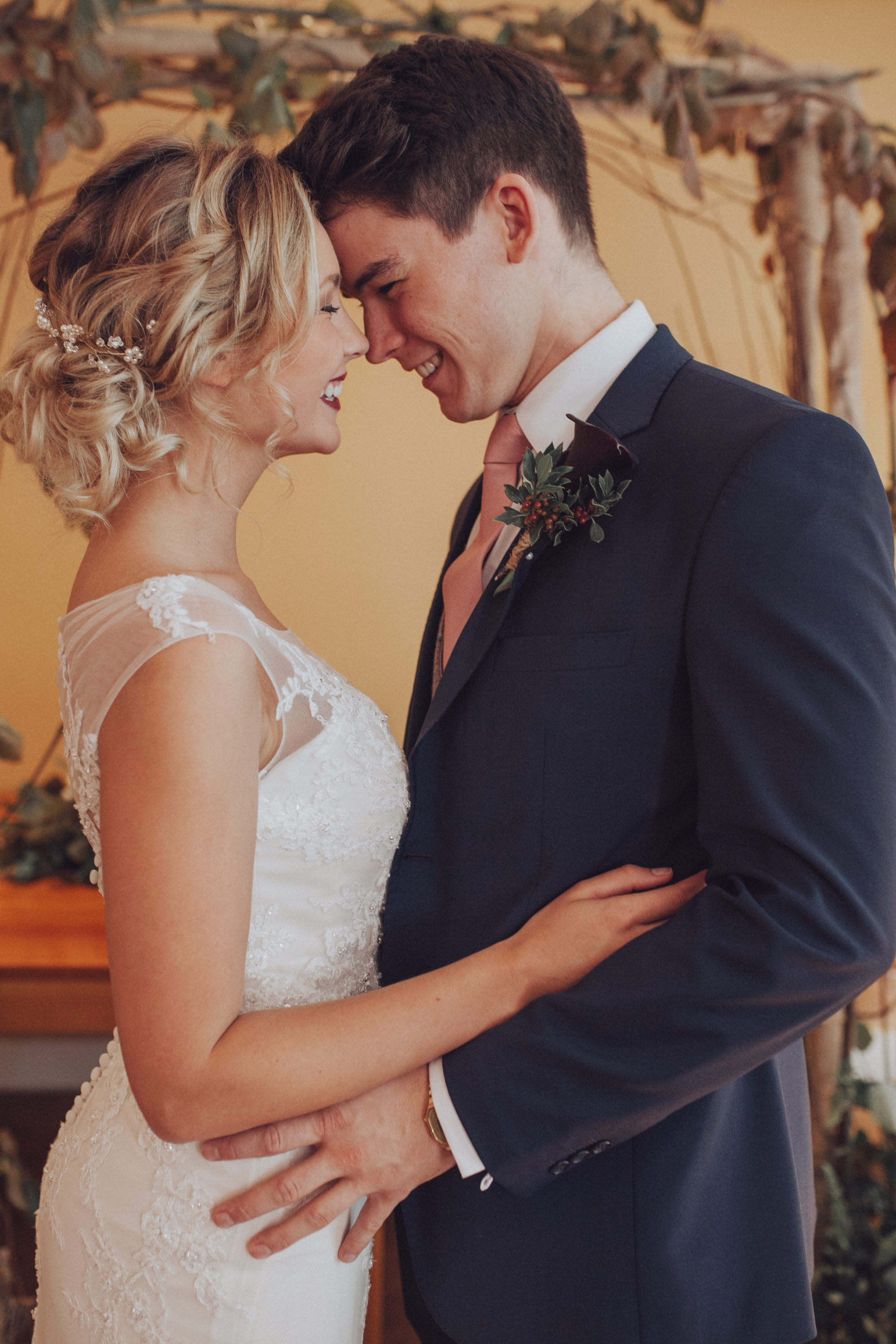 TerraVina-Styled-Wedding- side shot of hair, kissing groom.jpg