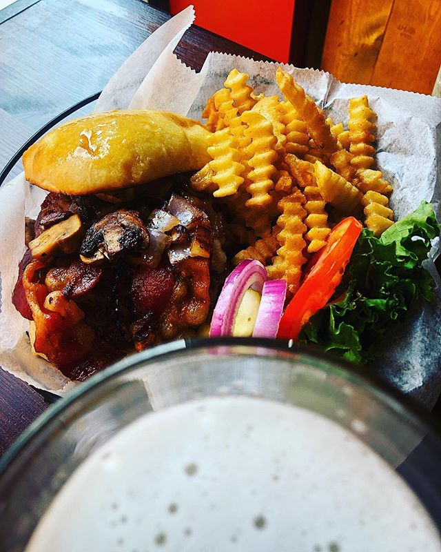 I'm gonna dive into this Mushroom and Swiss burger with added bacon. But first, just a sip. #omaha #omahane #omahabeer
