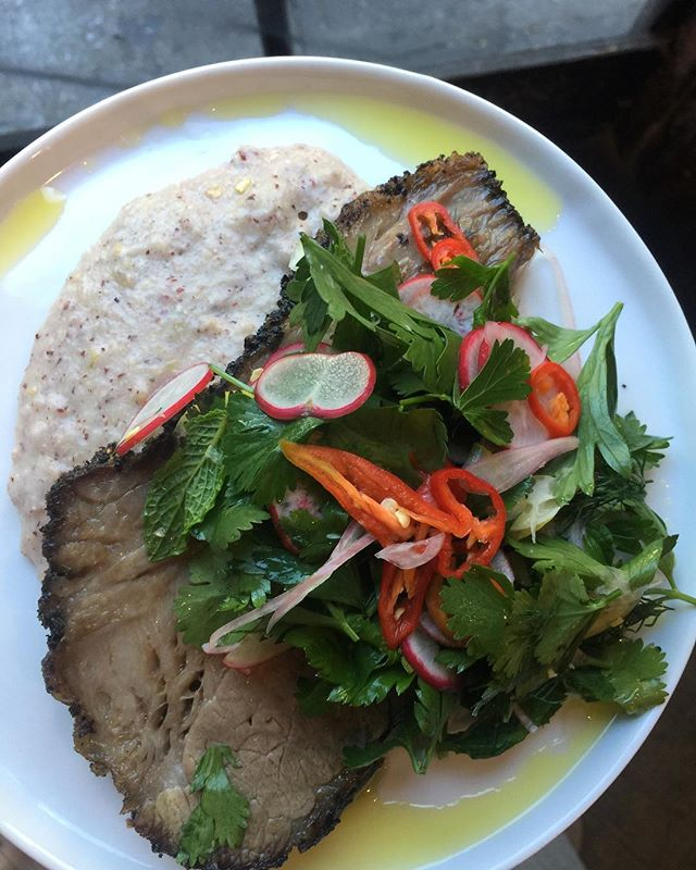 slow-cooked salt and pepper brisket with bloody butcher cornmeal polenta with roasted tomatillo and feta, radish and herb salad with pickled chiles and shaved lemon. here til it's not. be like lightning. brisket goes quick :)