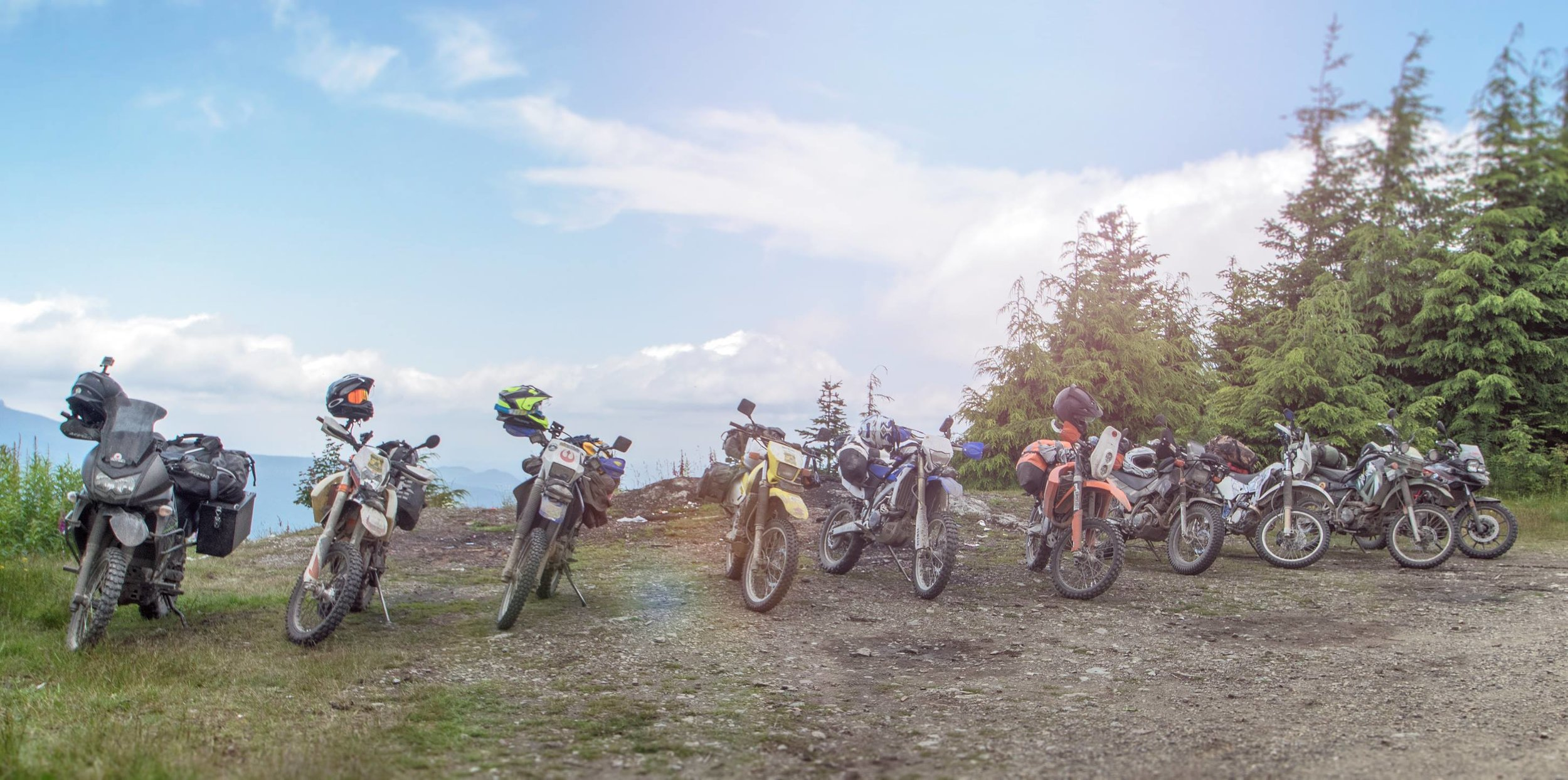 Group photo of the remaining riders at  Green Mountain viewpoint