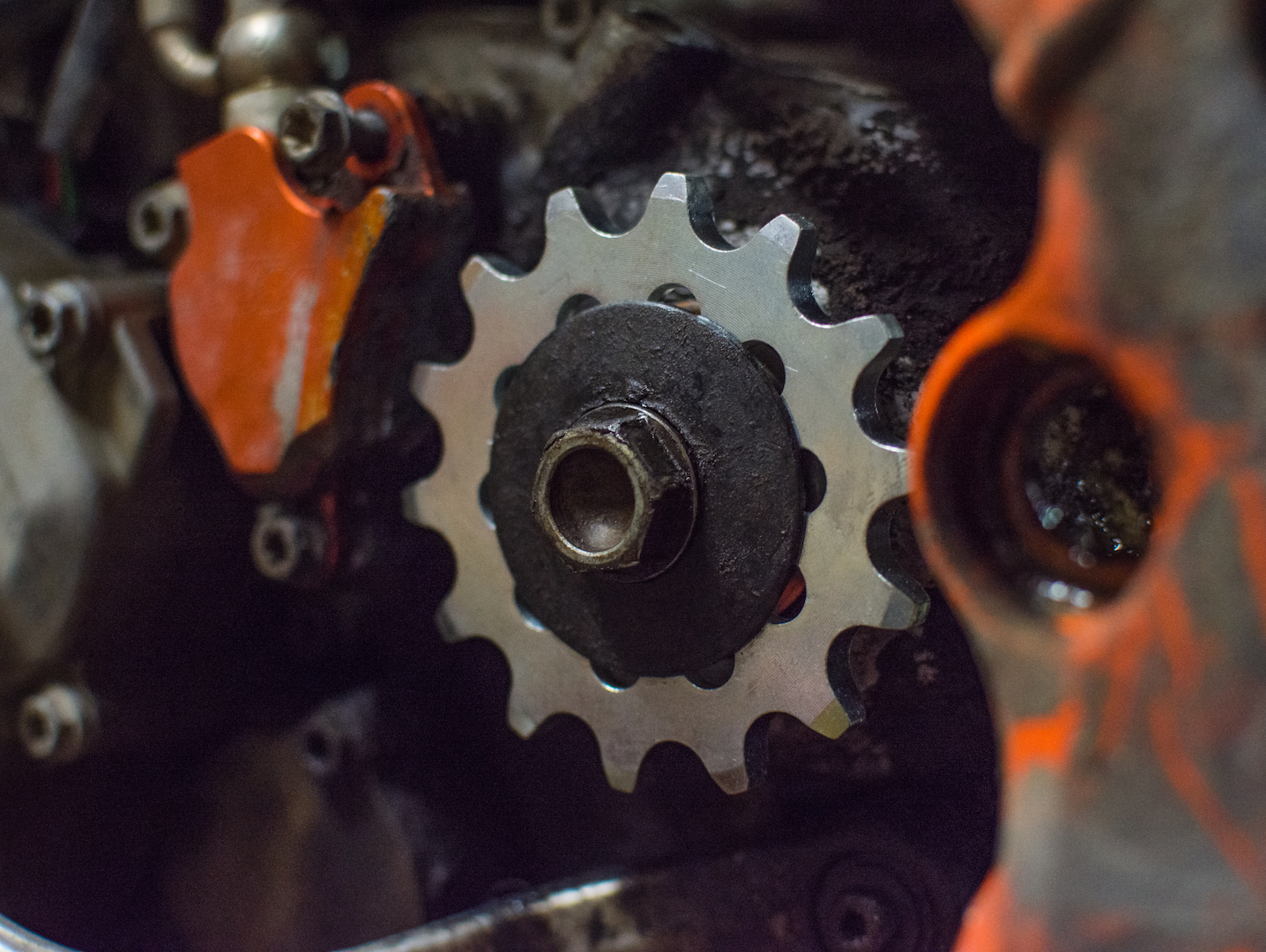 Adding the new OEM front sprocket. It looks even newer than new next to a dirty engine case!