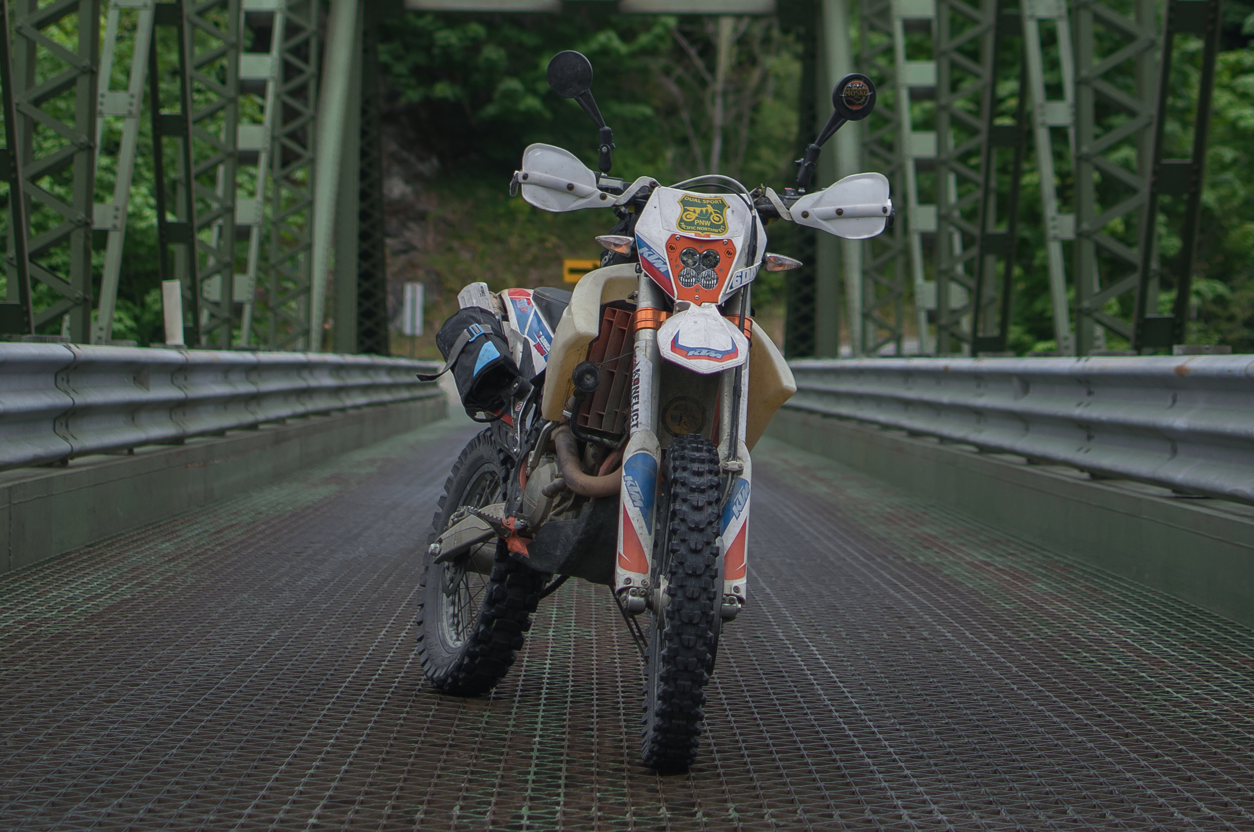KTM 500 on a day dual sport ride,with a Fatty Tool Roll attached to the grab handle.
