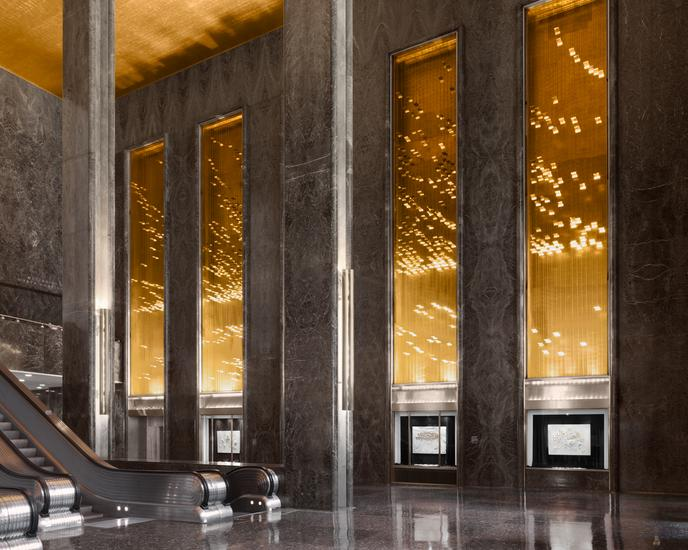 Vitrines in lobby of 45 Rockefeller Plaza. Photo by Dan Bradica, courtesy of Art Production Fund.
