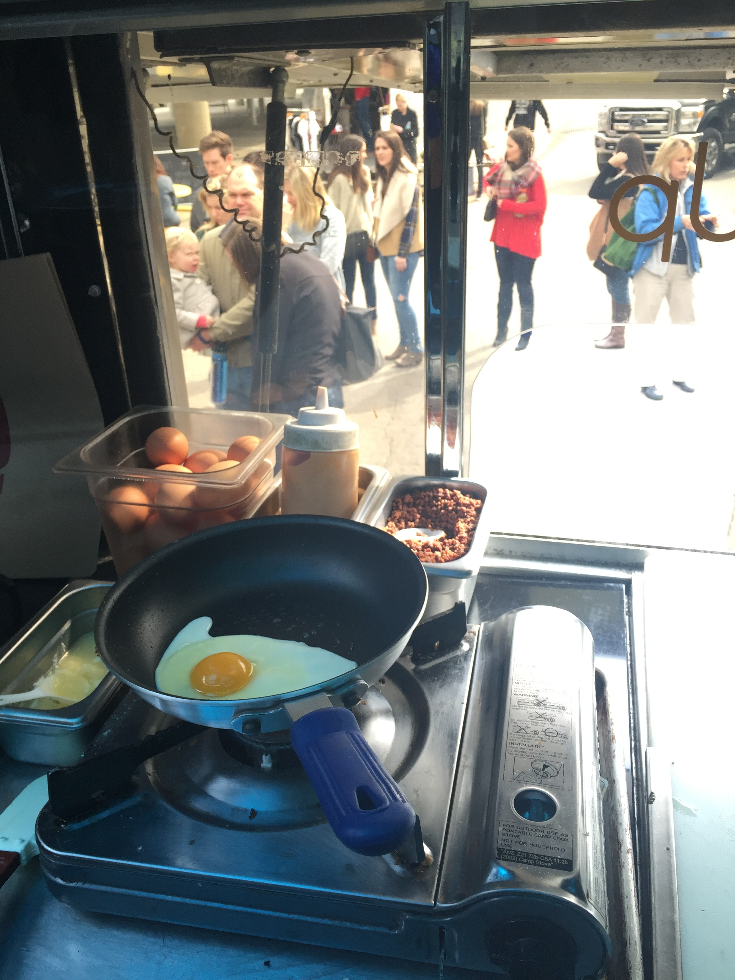 Local Eggs fried to order on our makeshift egg station...
