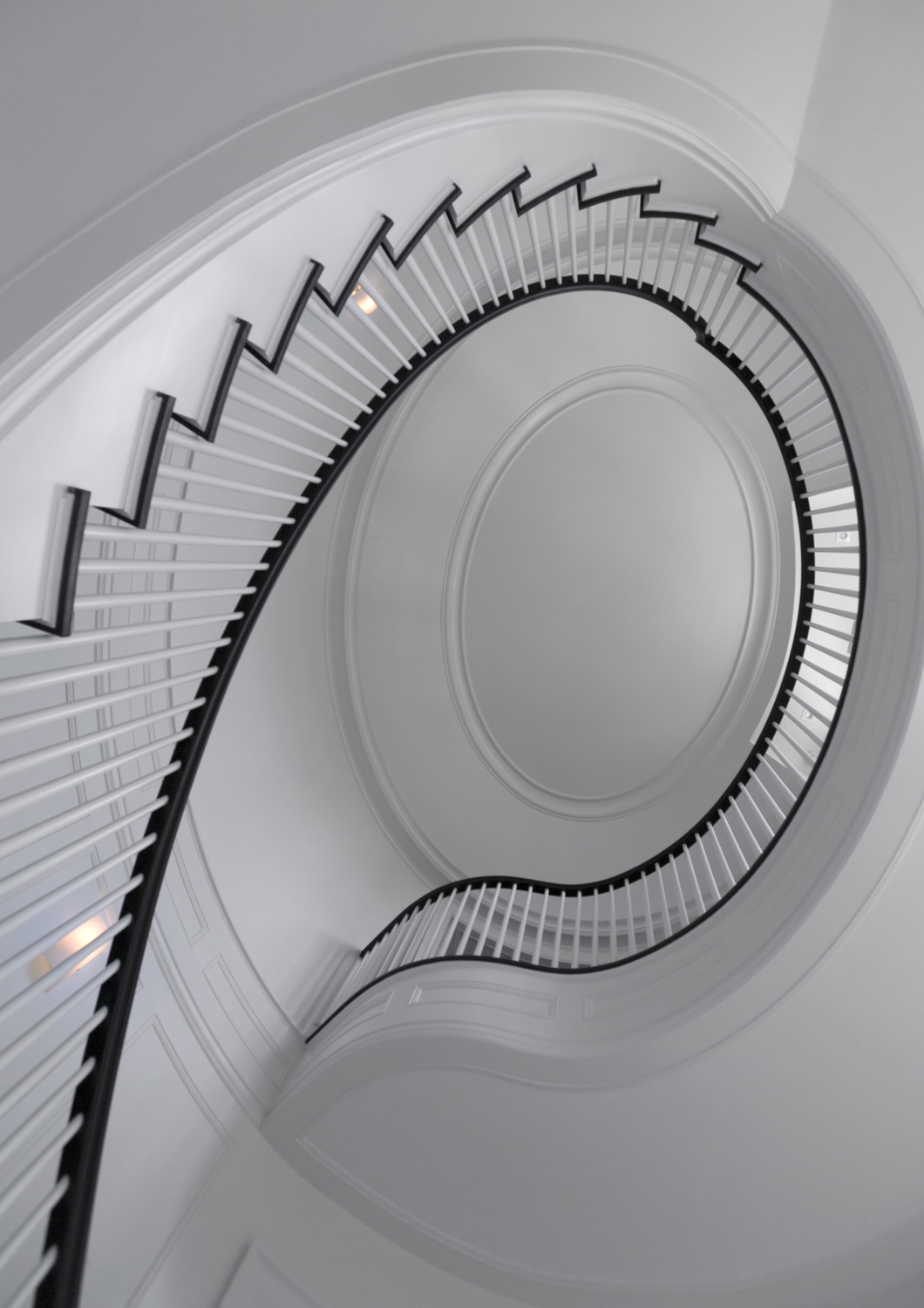 Limestone-grand-staircase-bannister-recessed-cove-ceiling-greenwich-ct-interior-w.jpg