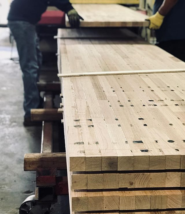 Before ⬅️ After - White Oak glue up table tops being sanded through the wide belt here @oindcorp - #oindcorp #premiumwoodproducts #whiteoak #tables #manufacturing
