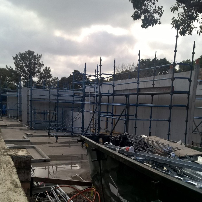 The side by side townhouses under construction.