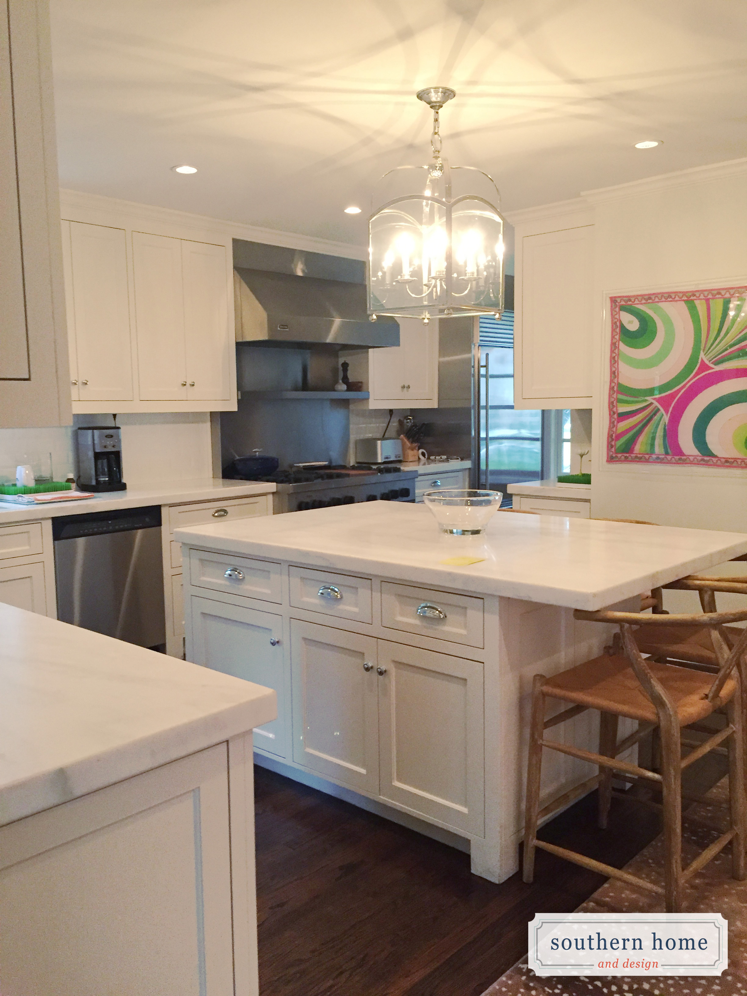 White kitchen with shaker style inset cabinets, honed danby marble countertops and stainless steel appliances.