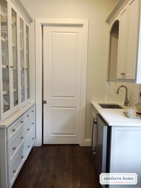 Built-in bar with Collinwood paint cabinets, wood floors, stainless applainaces.