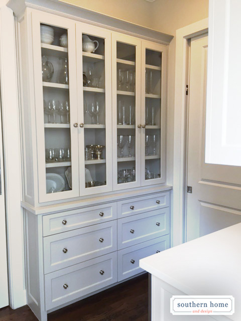 Custom breakfront cabinet with glass uppers and drawers add nice extra storage off kitchen in the butlers pantry/bar.