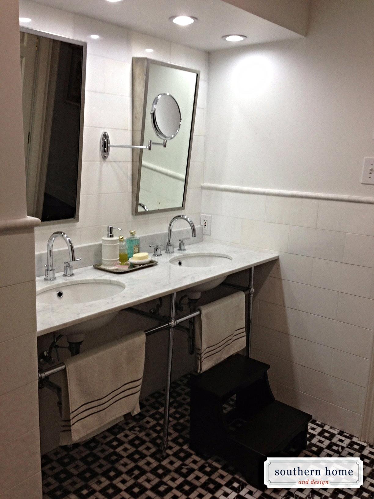 Modern, custom bathroom in Dallas. Angled mirrors, white sinks, and open design.