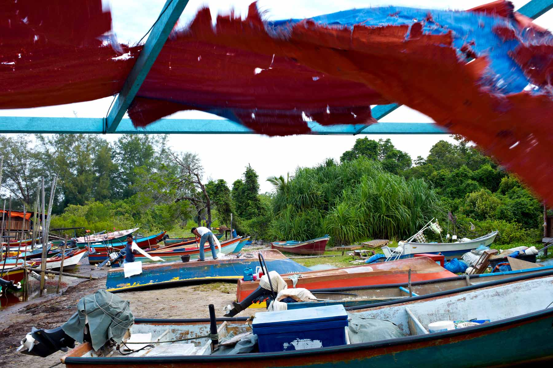 Boats line the shore of the fishing village