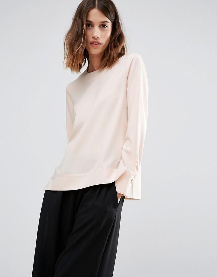 Warehouse dipped hem blouse via Asos