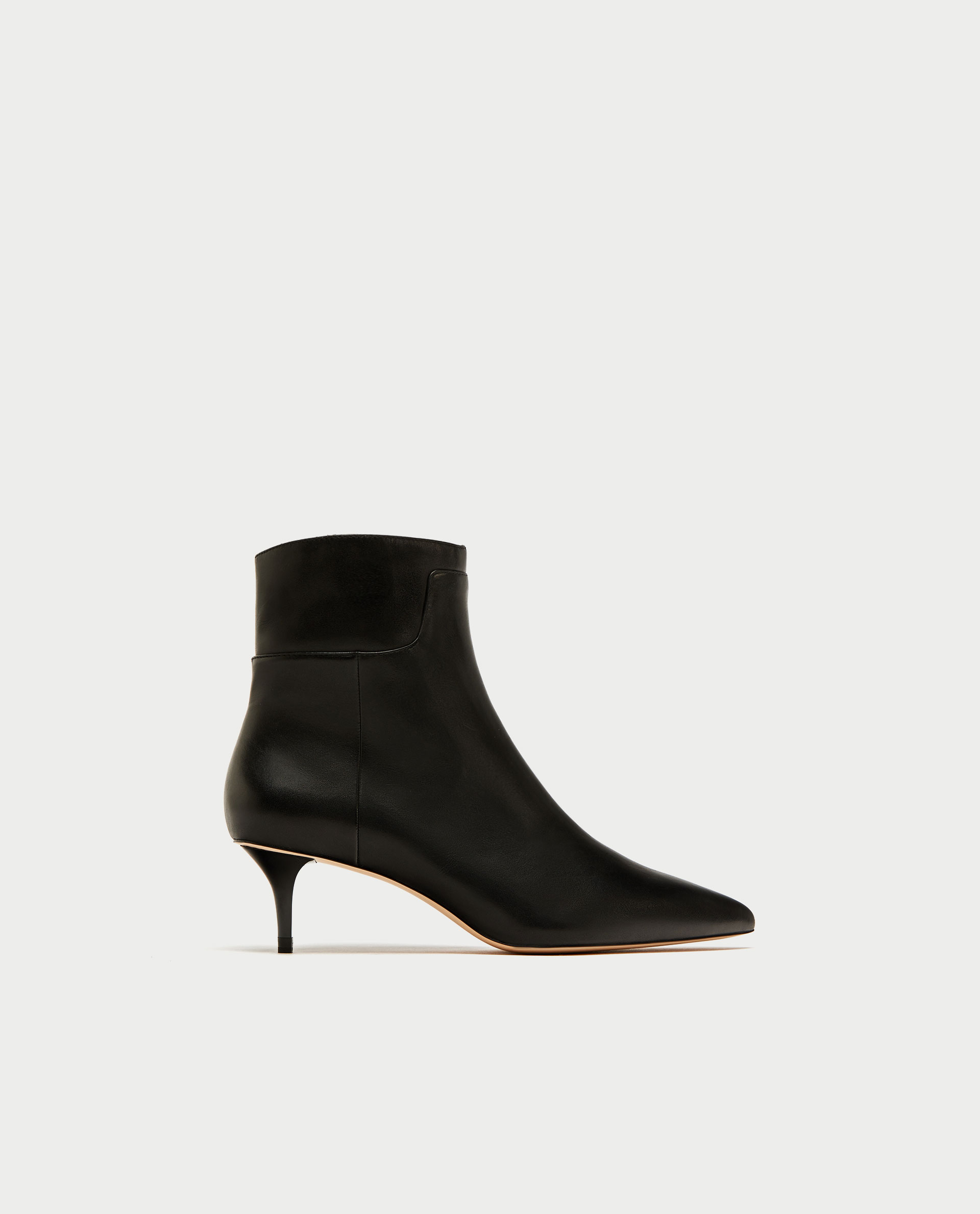 - LEATHER ANKLE BOOTS / Zara $100*photo via Zara