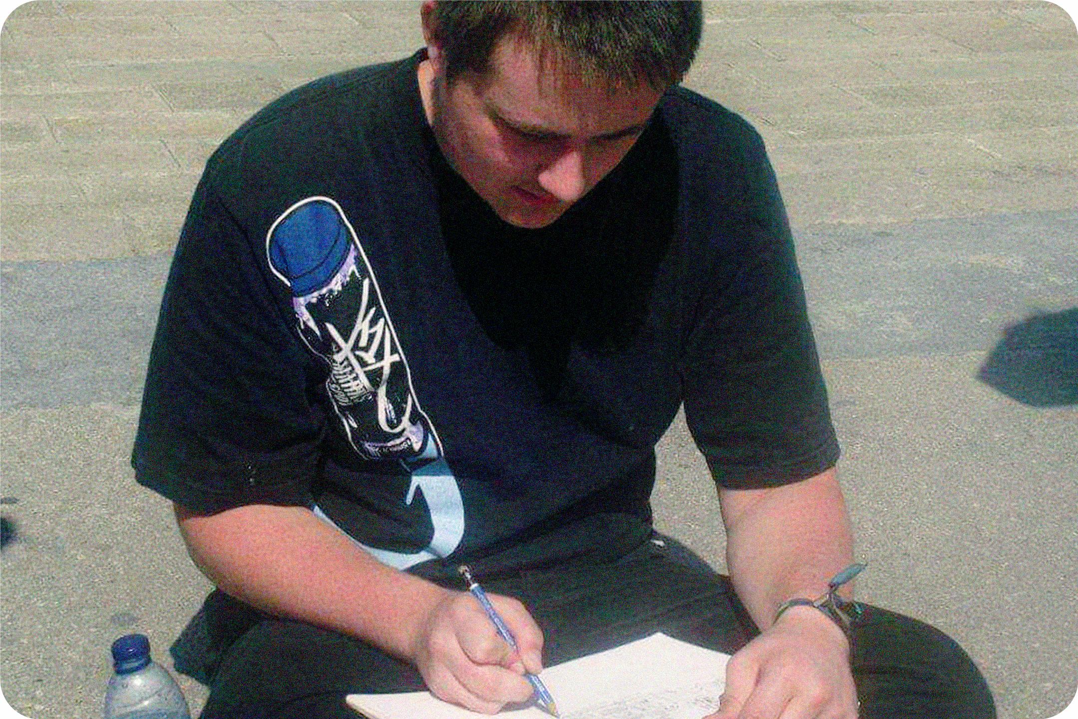 Teenage Luke, sketching out a mural in Belgium.
