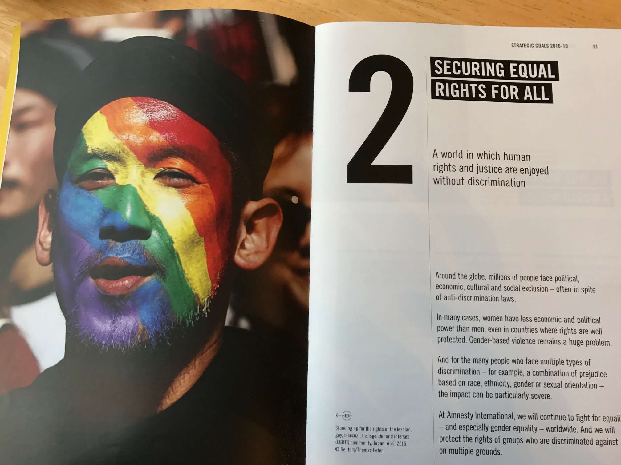 A campaigner with rainbow facepaint to illustrate Amnesty's goal of achieving equality for everyone.