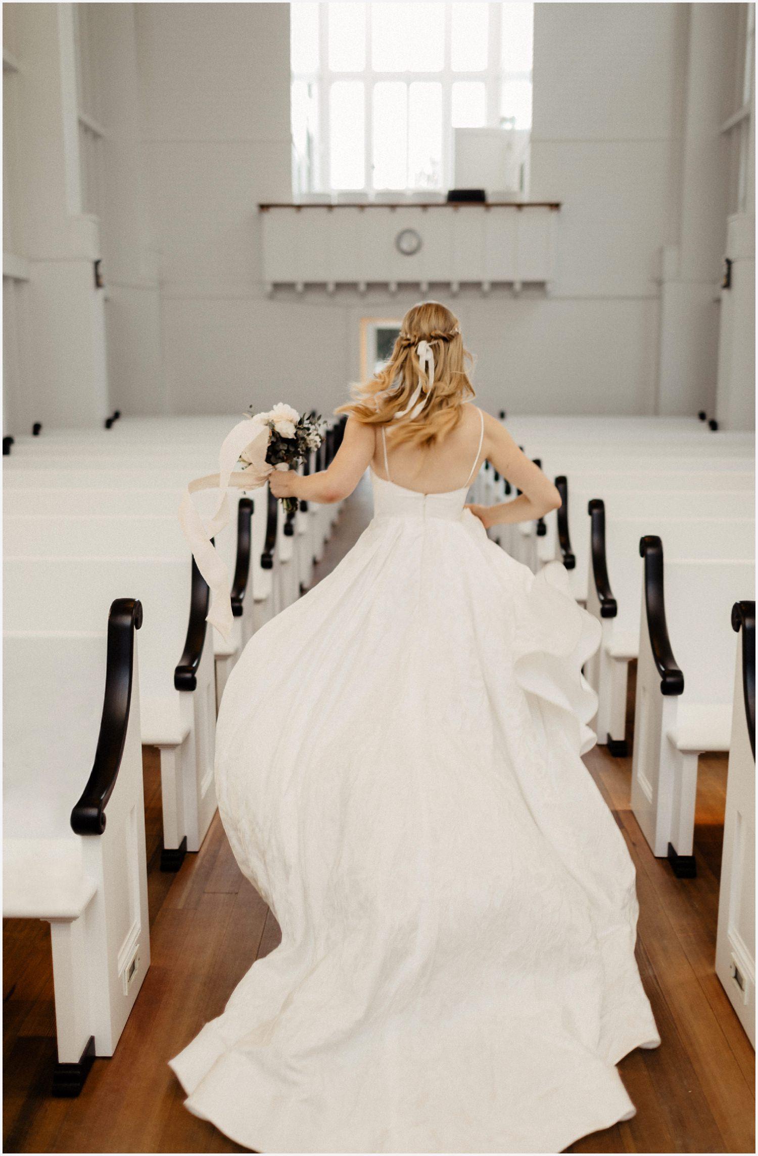 Bride running in the Seaside Chapel