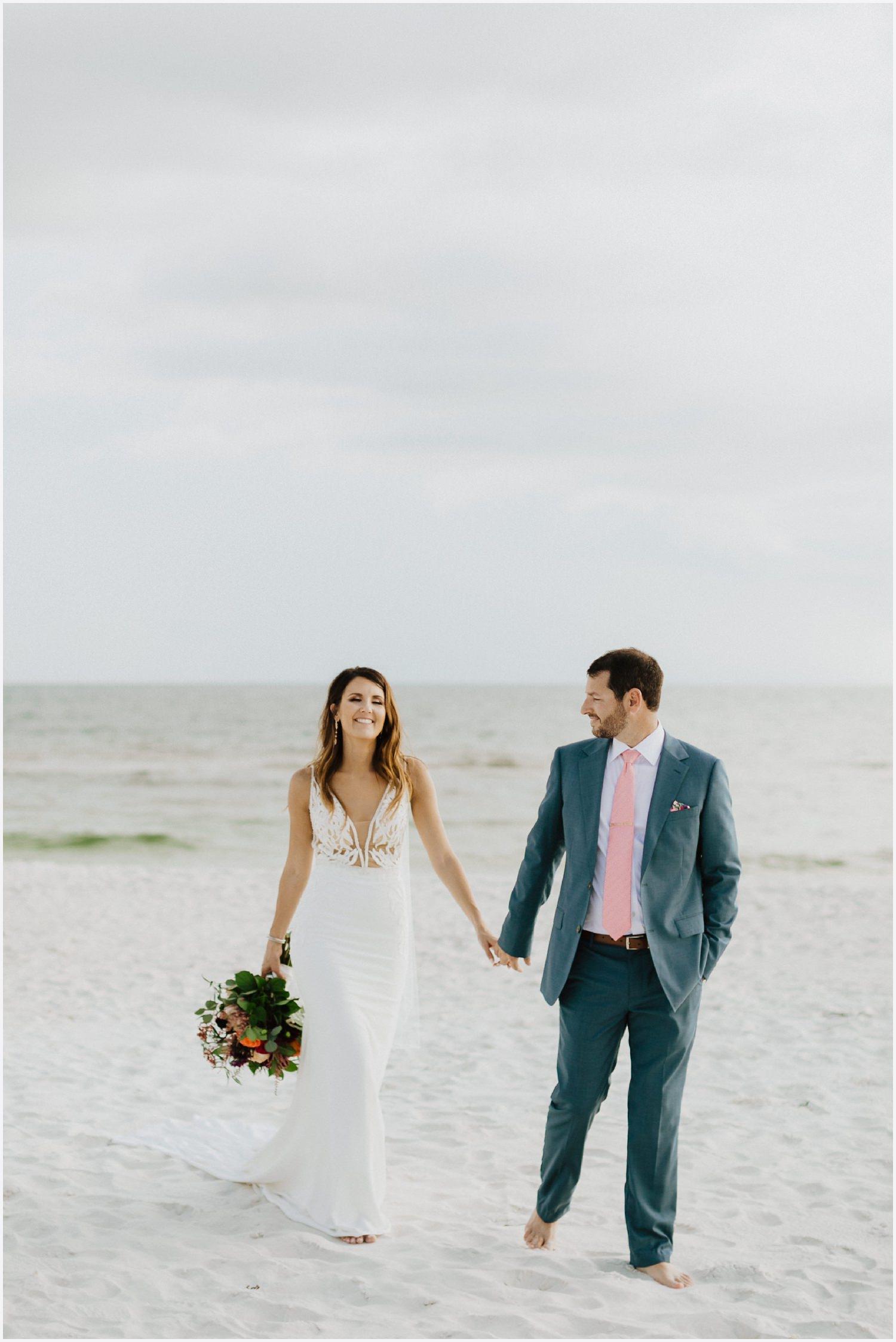 Bride and groom walking on Rosemary Beach