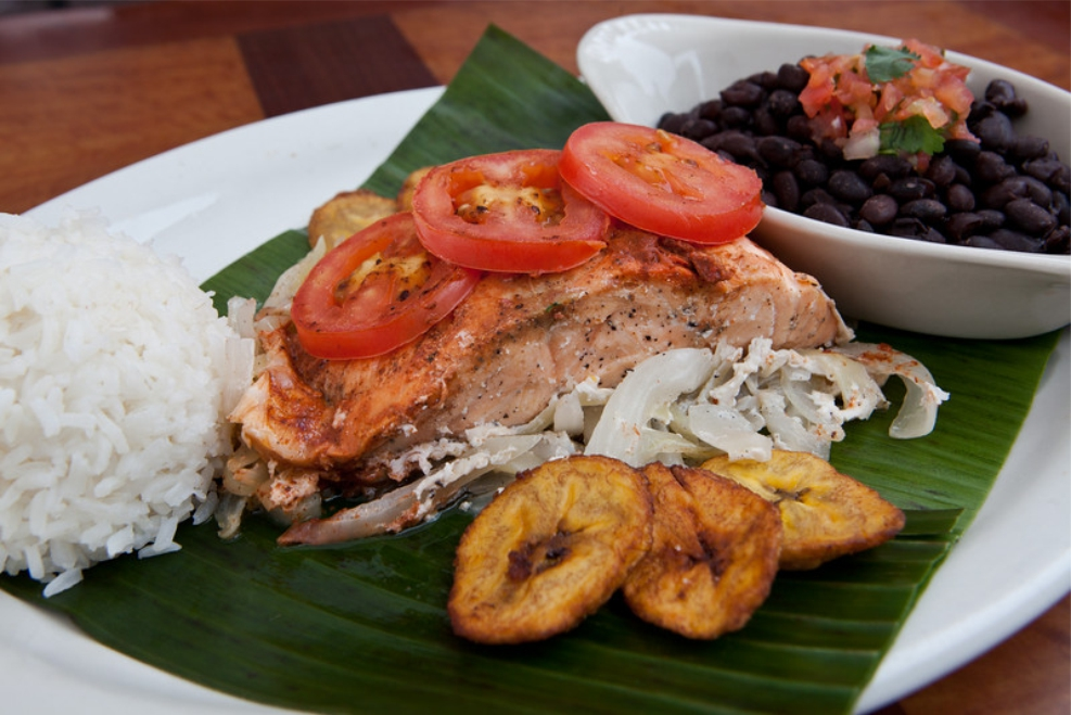 Aromatic banana leaf imparts flavor to our pescado en macum